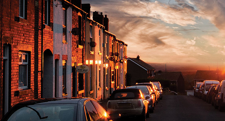 Row of houses down a street at sunset