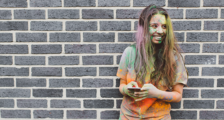 student covered with coloured powder