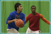 Two students playing basketball - the iSense can be adapted to all sports