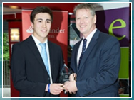 Alex Guntert receives award from Vice-Chancellor Colin Riordan