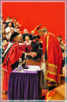 Dora Love recieves her Honorary Doctorate from the University's Chancellor, Lord Phillips of Sudbury