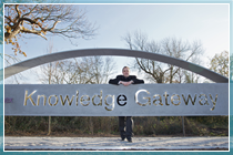 Registrar Bryn Morris at the entrance to the Knowledge Gateway
