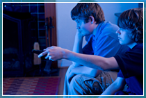 Children playing games consoles