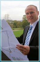 Andrew Hayward studies the plans for the site