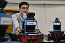 Researcher working with wheeled robot