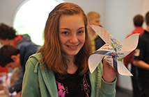 pupil with paper windmill