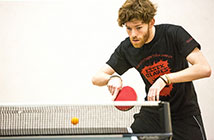 Student playing table tennis