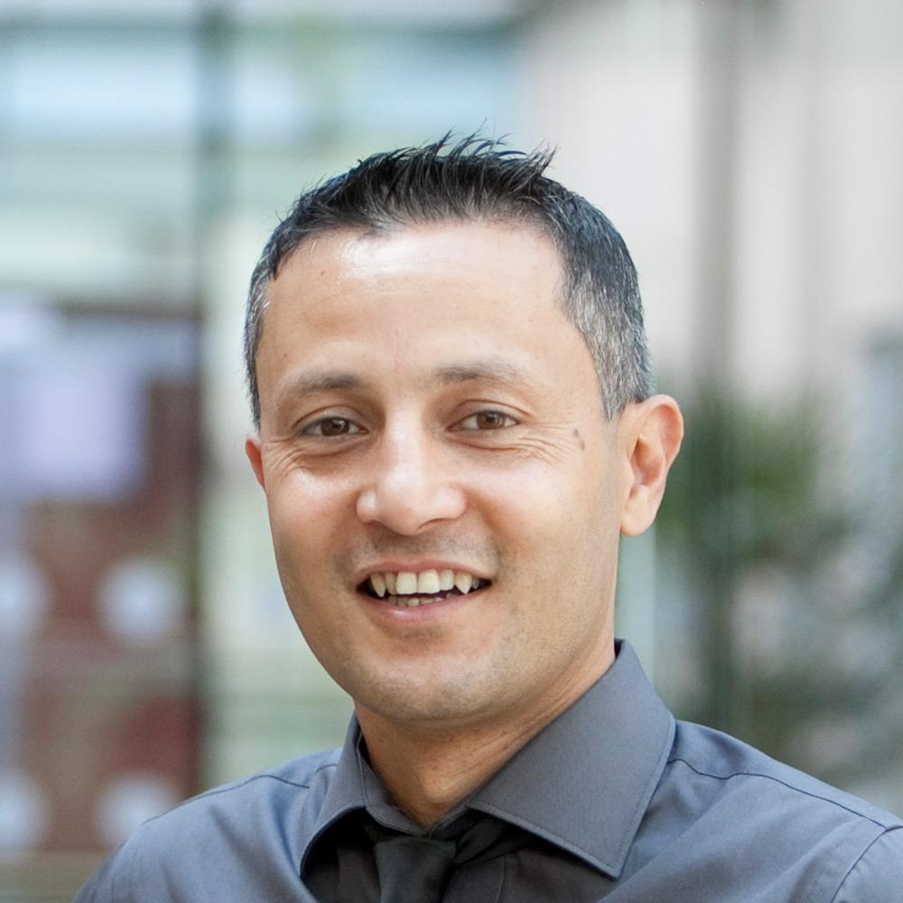 Dr Pawan Adhikari