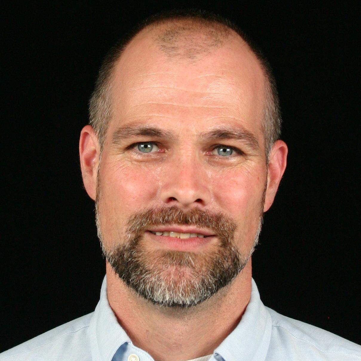 Dr Chris Main