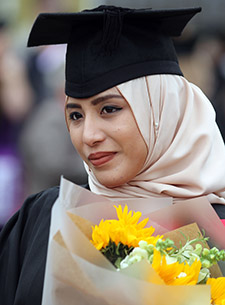 An image of a student at Graduation
